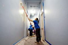 Volunteers painting a YWCA facility