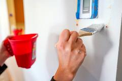 A volunteer painting a YouthCare facility