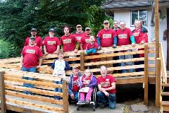 Arlington Hardware volunteer team with Rampathon recipient