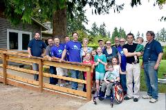 Chermak Construction President Noah France with Rampathon volunteer team and ramp recipients