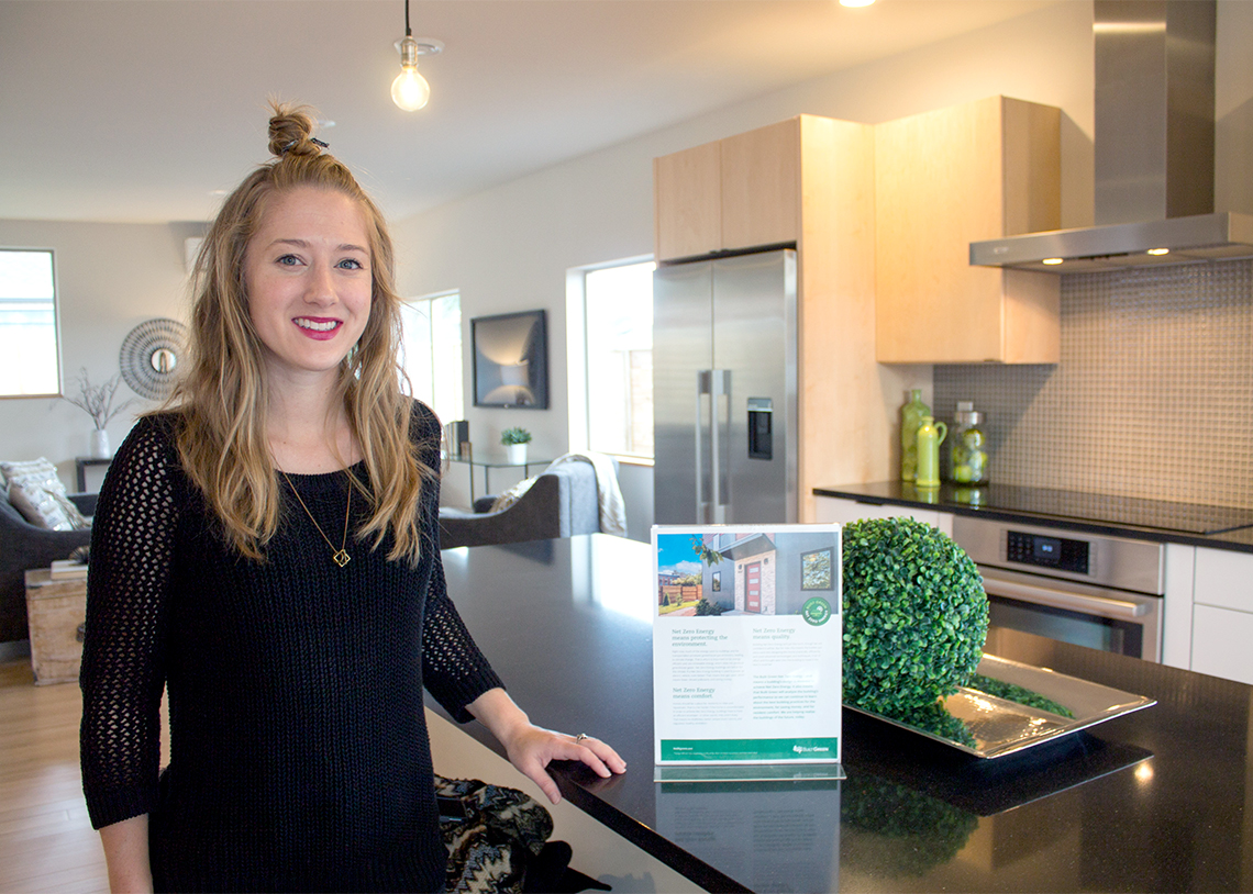 Lexy from Green Canopy Homes inside a Green Canopy Net Zero Energy home
