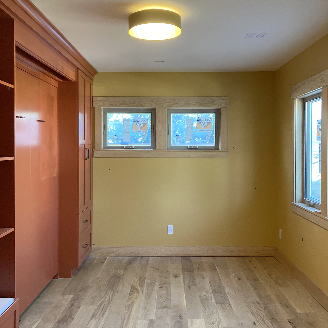 Brett Marlo Design Build Built Green 4-Star Tacoma remodel bedroom with murphy bed
