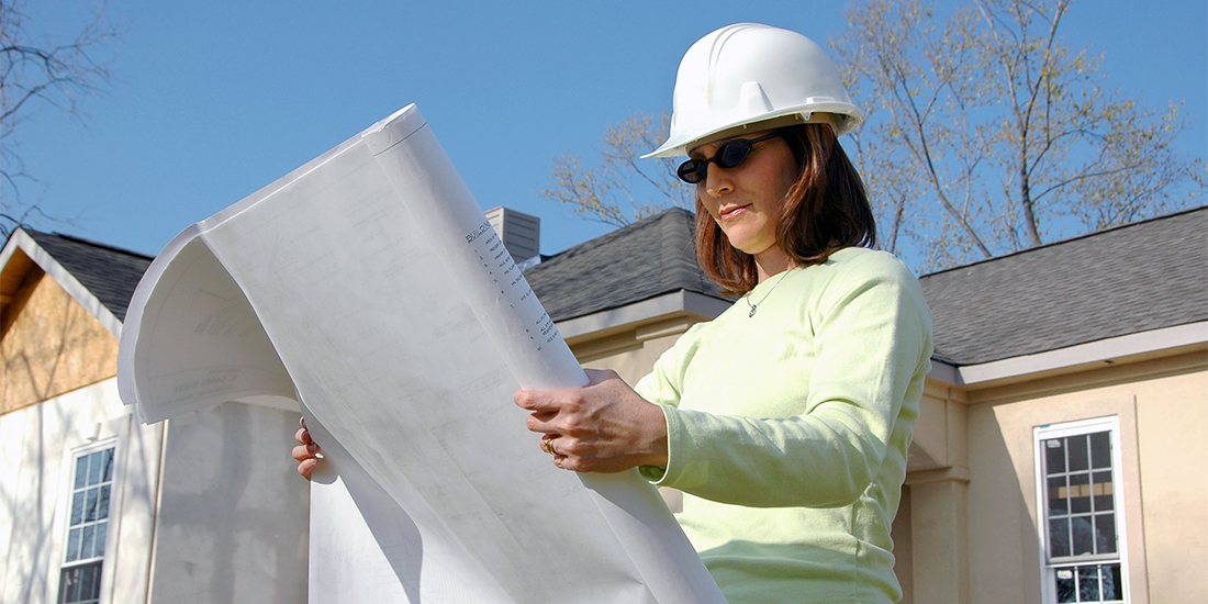 Contractor reviewing house plans