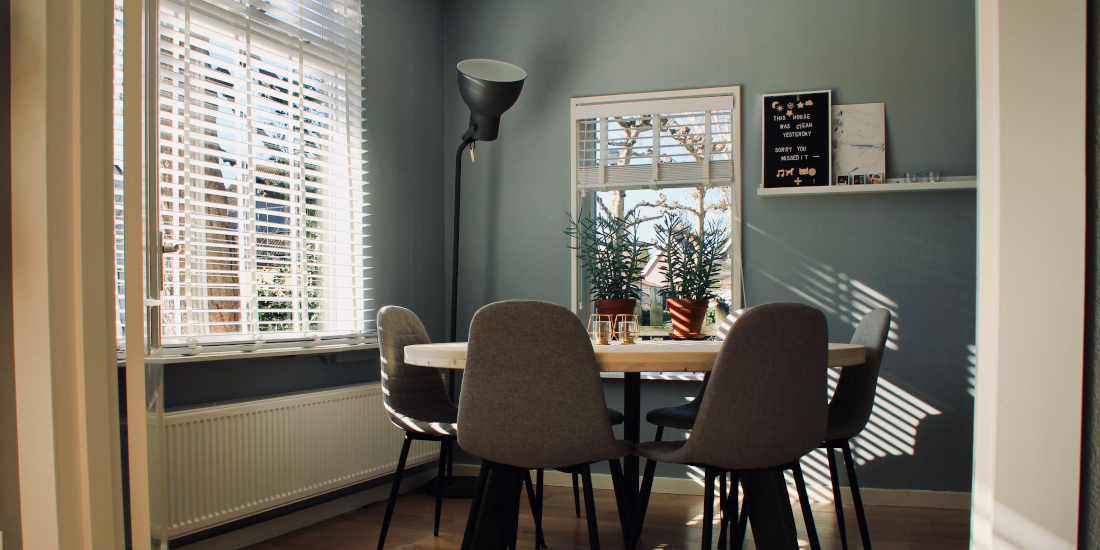 Dining room with multiple lighting sources