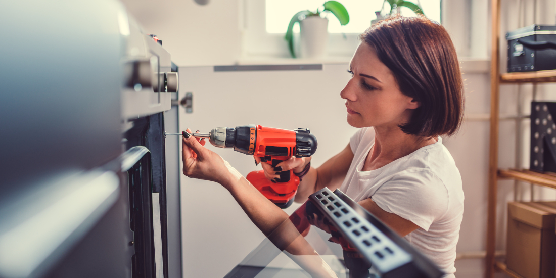 A woman does DIY repair work at home