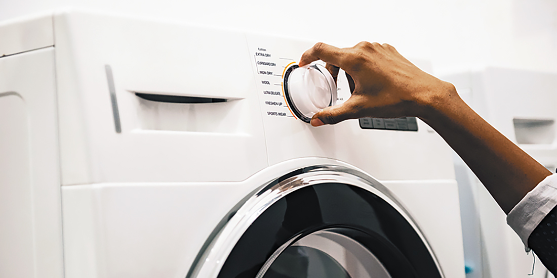 Homeowner using a washing machine